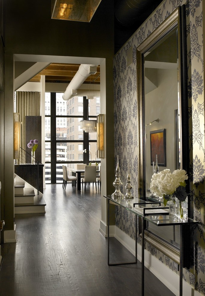 modern entryway table mirror vase decorations hardwood floors wallpaper staircase dining table chairs industrial design