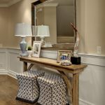 modern entryway table patterned ottomans mirror hardwood table horn sculpture lamp framed pictures hardwood floors traditional design