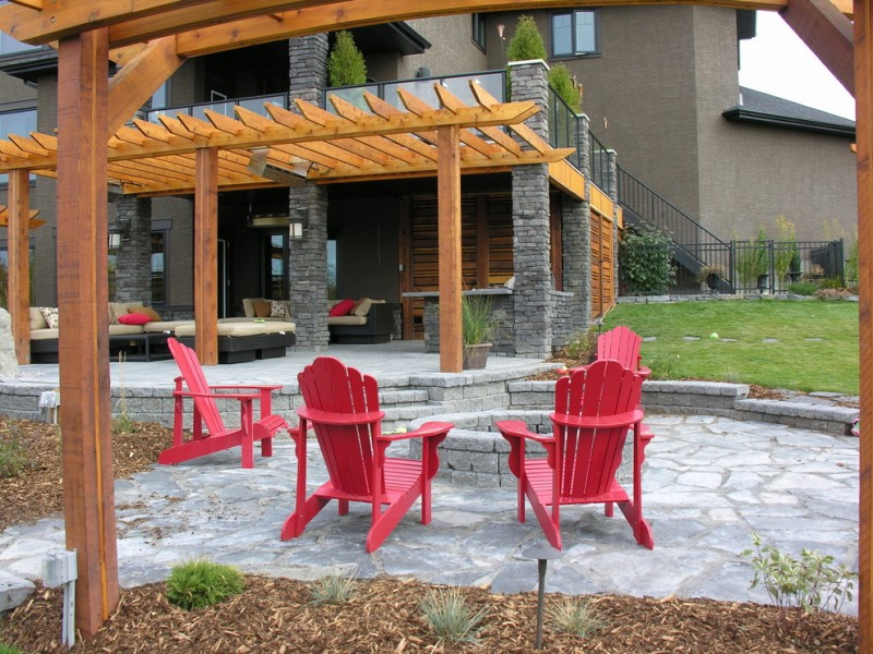 modern rustic patio idea with wooden pergola natural stone pavers for floors and vividly red chairs