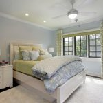 Multicolored Bedding Idea Contemporary Bed Frame In White White And Fluffy Area Rug White Bedside Tables With Storage Systems Light Blue Walls White Ceillings