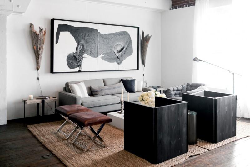 nate berkus furniture coffee table leather ottomans grey sofa standing lamp sidetable rug hardwood floors artworks beach style