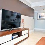 nate berkus furniture sideboard shelf ceramic floors ceiling lights framed painting tv decorations contemporary design
