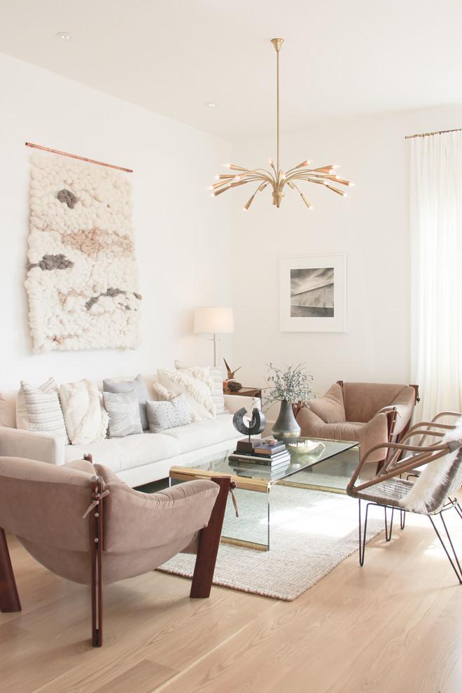 nate berkus furniture sofa comfy chairs armchairs chandelier glass table sidetabla lamp hardwood floor wall decorations scandinavian design