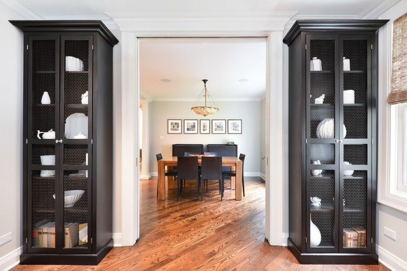 nate berkus furniture tall display rack hardwood floor wood table chairs chandelier framed painting window blind transitional design