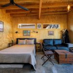 one bedroom cabin plans bed built in bookshelf benches table couch glass door column ceiling light fixtures fan decorations industrial design