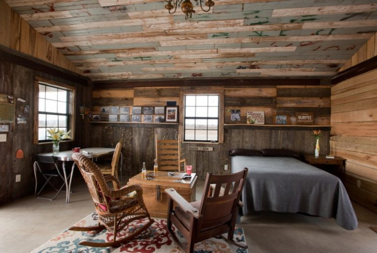 One Bedroom Cabin Plans Bed Rocking Chairs Ottoman Narrow Table Armchairs Concrete Floors Carpet Decorations Windows