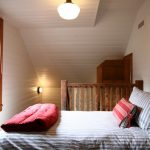 one bedroom cabin plans bed window plank walls pillows wall lamp wood railing pendant rustic design