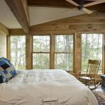 one bedroom cabin plans stone surround fireplace rocking chair bed ceiling fan screen panel windows carpet rustic design