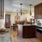 Open Concept Kitchen In Traditional Style Angled Cabinet Made Of Dark Hardwood Dark Hardwood Dining Furniture I Shaped Countertop With Dark Wood Cabinets Granite Top Kitchen Island With Under Storage