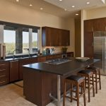 Open Concept Kitchen Solid Wood Corner Cabinet Integrated With Stainless Steel Appliances I Shaped Countertop Black Top Kitchen Island Integrated With Breakfast Bar Bar Stools