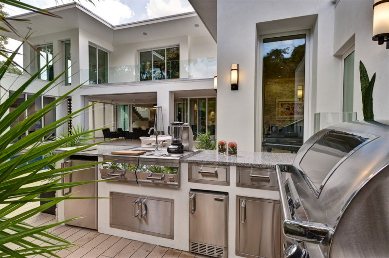 outside kitchen design modern lamps cabinets drawers countertop faucet sink contemporary patio