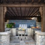 outside kitchen design stove cabinet table decorative plants faucet sink mediterranean patio
