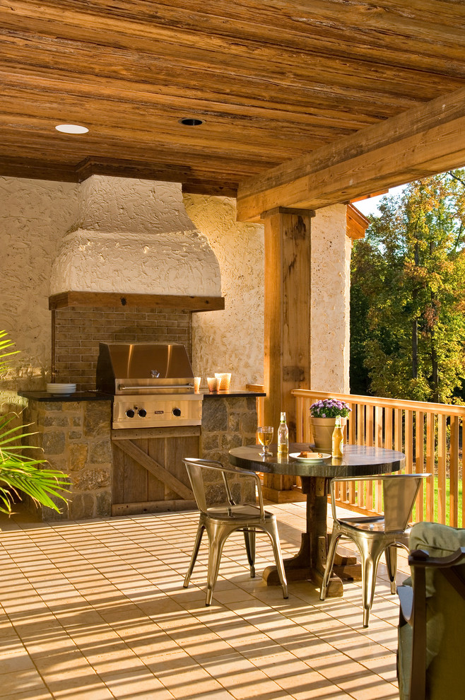 outside kitchen design stove table chairs flowers rustic porch