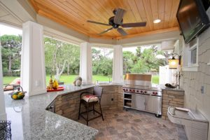 outside kitchen design stove wall tv faucet sink chair countertop ceiling fan meditarranean patio lights