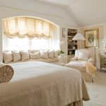 Paris Inspired Bedroom Bed Pillows Bookshelves Books Bench Chair Small Table Window Lamps Flowers Mirror Traditional Room