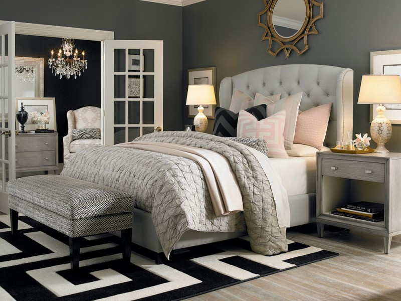 paris inspired bedroom carpet light coloured floor bed pillows bedside tables lamps mirror blanket chandelier contemporary room