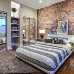 Paris Inspired Bedroom Wood Floor Carpet Bed Pillows Bedside Tables Lamps Shelves Big Mirror Ceiling Light Paintings Modern Bedroom