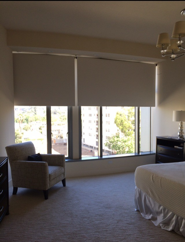 penthouse in los angeles bed chair tables windows shades chandelier lamp modern bedroom