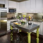 penthouse in los angeles dark floor seating island knives wall cabinets flowers sink faucet modern kitchen