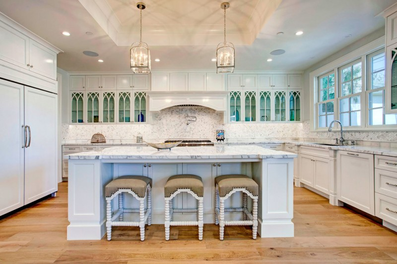 penthouses in los angeles beautiful floor cabinets island stools chandeliers ceiling lights countertop stove traditional kitchen