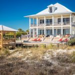 Piling House Plans Beach Style Exterior White Metal Roof Double Porch And Deck Pop Red Chairs Small Wooden Gazebo
