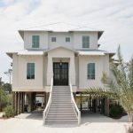 Piling House Plans White Wooden House Metal Roof Wood Piling Nice Dormers Traditional Entrance Chandelier Decorative Palm