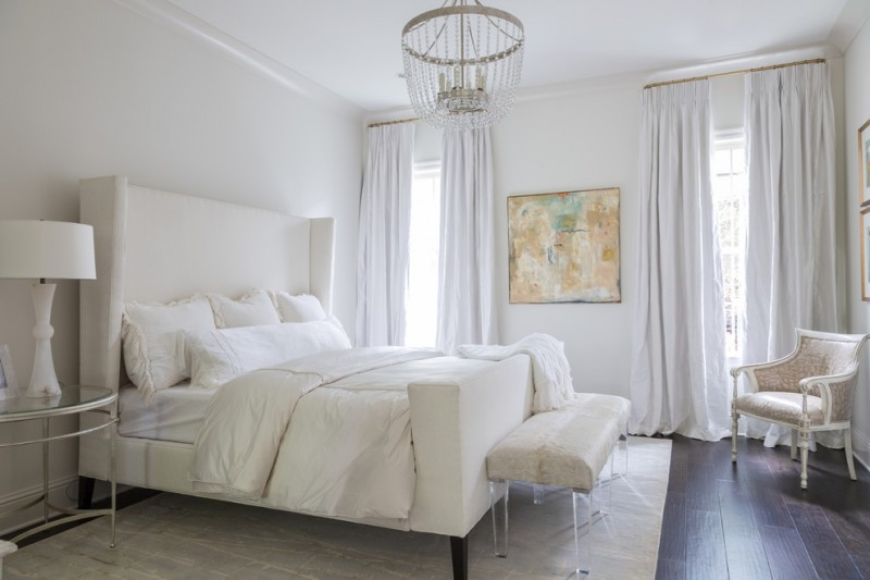 pure & clean white bedding treatment white bed frame with higher & white headboard oval top glass side table white area rug dark hardwood floors crystal pendant lamp