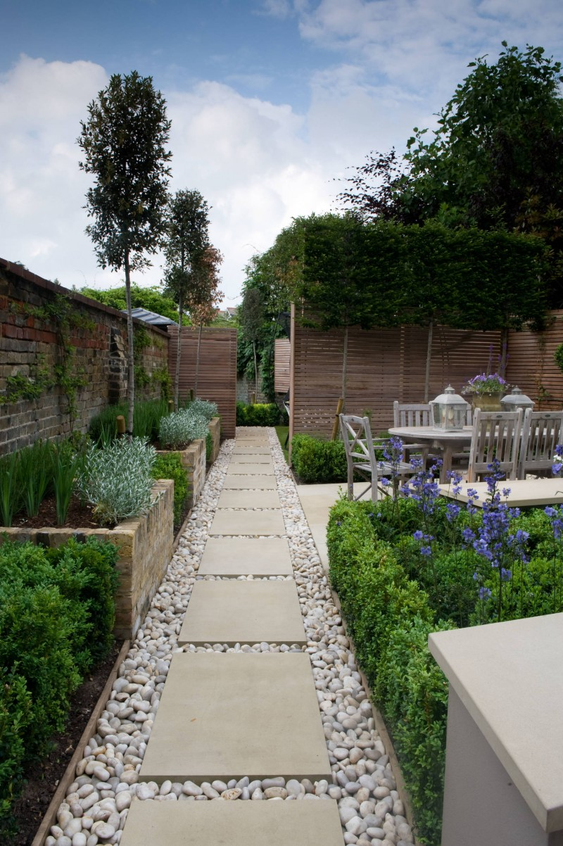 rock pathway flagstone brick space garden plants purple flowers outdoor dining space wooden sides