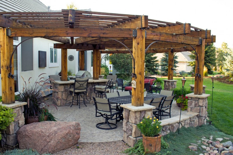 rustic patio with shabby wood pergola supported with hard metal connectors and supports some sets of hard metal furniture concrete floors outdoor kitchen