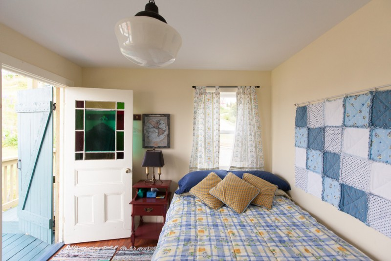 simple guest room linen made wall arts white window curtains with motifs maroon bedside table blue bedding treatment
