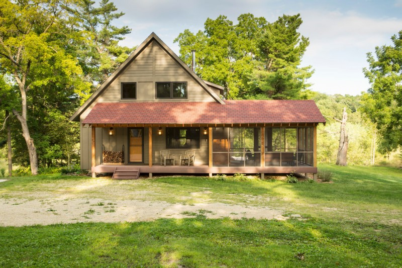 small rustic house plans grass trees porch chairs firewood windows lamps small pillars beautiful exterior