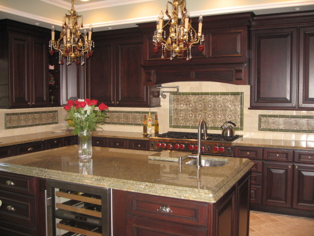spanish tile backsplash dura supreme cabinetry sub zero wine storage cooler decorative tiles beautiful gold chandeliers granite countertop