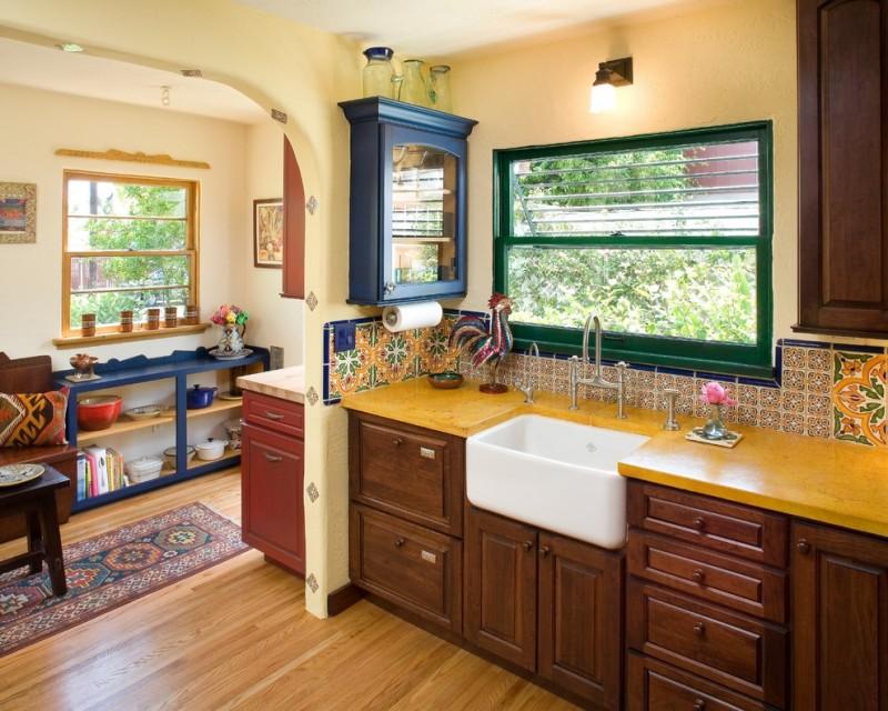 spanish tile backsplash mediterranian kitchen yellow top decorative backsplash wide window wood cabinet pendant