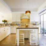Spanish Tile Backsplash Turkey Red And Orange Cut Stone Travertine Traditional Dining Table Large Glass Doors And Window Spanish Style Kitchen