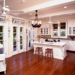 Spanish Tile Backsplash White Kitchen Cabinet And Kitchen Bar Barstools Wood Flooring Ceiling Fan With Lamp Traditional Chandelier