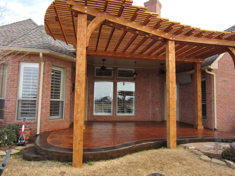 stained patio with red wood pergola red bricks walls dark brown ceramic floors