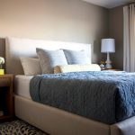Steel Blue White Bedding Idea Neutral Window Curtains Light Beige Walls A Pair Of White Table Lamps Wooden Bedside Tables Multicolored Area Rug