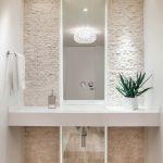 Stone Wall Floating Vanity Built In Sink Pendant Light Recessed Lights Tiled Wooden Floor Floor To Ceiling Mirror Flower Arrangement