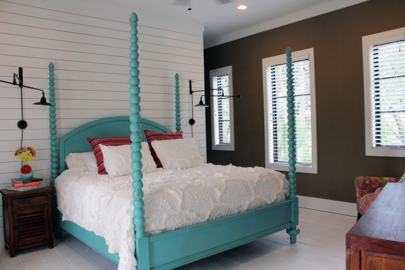 textured white bed treatment idea with red stripes and white shams turquoise bed frame with pillars dark hardwood bedside table white siding walls brown walls with interior windows