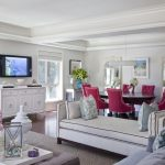 Timeless Living Room Remodel With White Walls And A Wall Mounted Tv Red Accent Chair Pillow Throws White Painted Cabinet Cream Rug