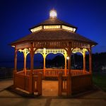 Traditional Wooden Gazebo With Simple Lights On Top Of The Ceiling