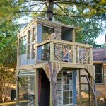 treehouses for kids deck wood stairs balcony large windows door metal bucket contemporary design