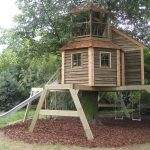 treehouses for kids slide swings wood walls windows balcony traditional design