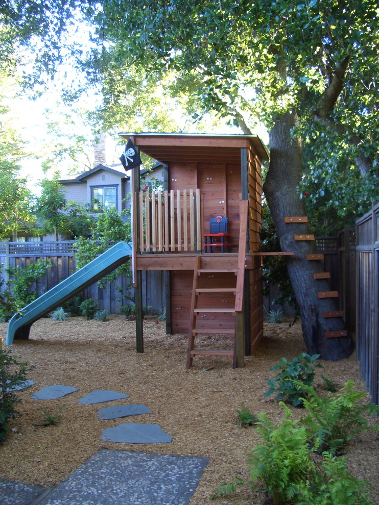 treehouses for kids wood exterior stairs slide playset plastic chair stone pavers fence traditional design
