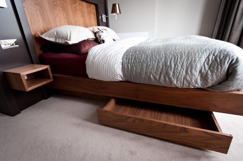 under the bed storage ideas drawer bedding headboard hanging sidetable light fixture carpeted floors contemporary design