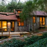 Vacation Home Eclectic Exterior In Sloped Site With Glass Windows And Wooden Deck Walls Patio Fencing