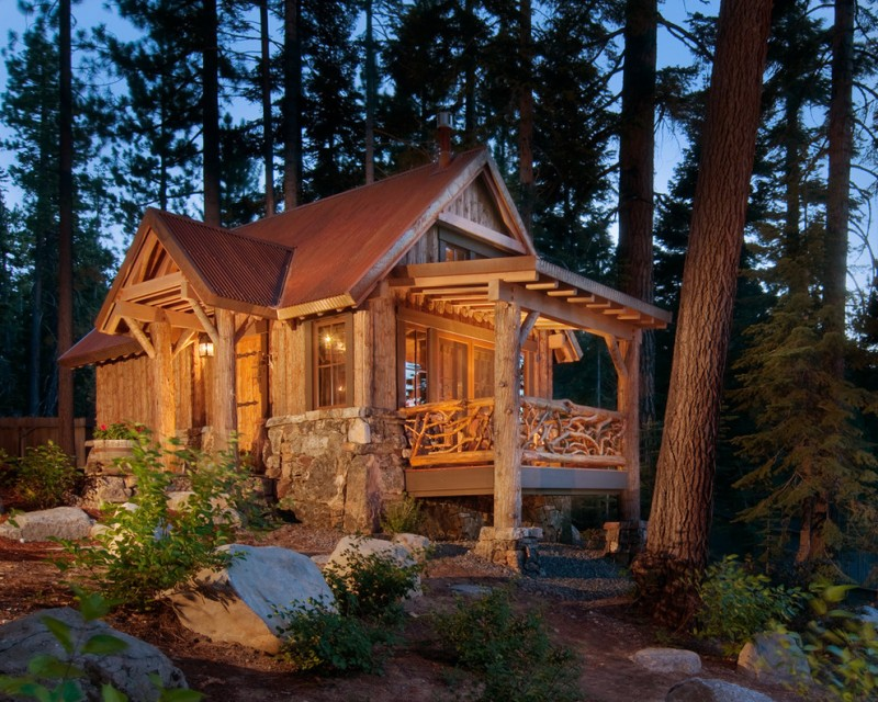 vacation home rustic exterior cemented stone brick flooring timber post wooden branches fence wooden log wall