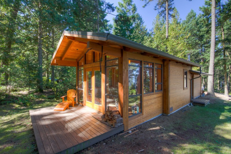 vacation home rustic exterior glass walls and windows wooden deck walls and patio floor wooden chair
