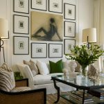 wall decorating ideas for living room artwork sofa armchair glass top table carpet lamps transitional design