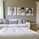 wall decorating ideas for living room black and white family photos sofa tufted ottoman throw pillows carpet basket contemporary design